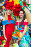 Two young women in colourful costumes at the Flower Festival, Madeira. FUNCHAL, MADEIRA, PORTUGAL - APRIL 19, 2015: Two young women in colourful costumes at the Royalty Free Stock Images