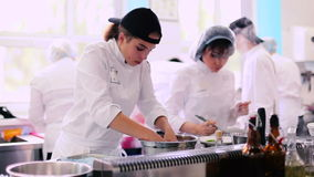 Two young women are cooking on the kitchen in the restaurant stock footage