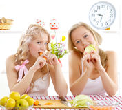 Two young women cooking salad Royalty Free Stock Images