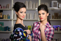 Two young women in cosmetics store Royalty Free Stock Photos