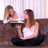 Two young women discussing Royalty Free Stock Photo