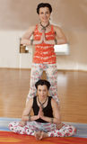 Two young women do yoga Royalty Free Stock Photos
