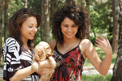 Two young women and dog Stock Photo