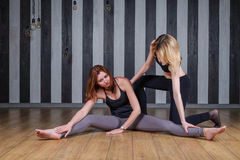 Two young women doing gymnastics and stretching stock photo