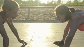 Two young women doing push-ups. And clapping hands stock footage