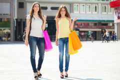 Two young women doing shopping Royalty Free Stock Photo