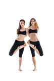 Two young women doing yoga asana Stock Photo