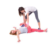 Two young women doing yoga stretching exercises Royalty Free Stock Photo