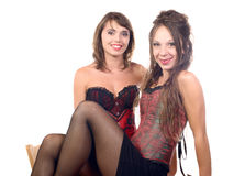 Two young women dressed in a corset Royalty Free Stock Images