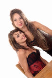 Two young women dressed in a corset Stock Photos