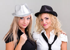 Two young women dressed for a party Stock Photos