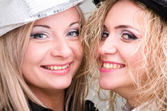 Two young women dressed for a party Stock Images