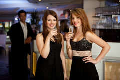 Two young women drinking chanpagne royalty free stock photo