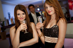 Two young women drinking chanpagne Royalty Free Stock Photos