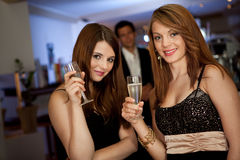 Two young women drinking chanpagne Royalty Free Stock Photography