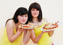 Two young women eating Royalty Free Stock Photo