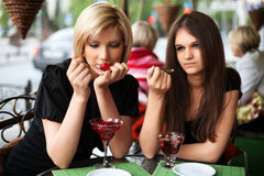 Two young women eating a dessert Stock Photo