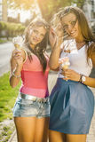 Two young women eating ice cream Stock Photo