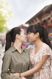 Two young women embracing Stock Photos