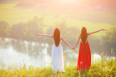 Two young women enjoying nature Stock Images