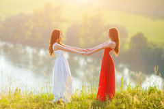 Two young women enjoying nature stock image