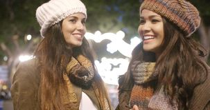 Two young women enjoying a night on the town stock footage