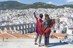 Two young women enjoying the sea view in Kavala, Greece Stock Photos