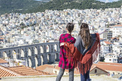 Two young women enjoying the sea view in Kavala, Greece Royalty Free Stock Image