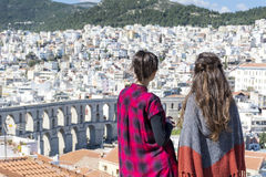 Two young women enjoying the sea view in Kavala, Greece Stock Photography