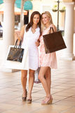 Two Young Women Enjoying Shopping Stock Photos