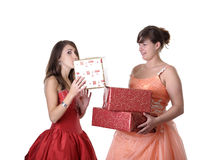 Two young women in evening gown with xmas presents Stock Photo