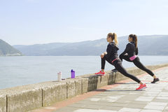 Two young women exercising Royalty Free Stock Photo