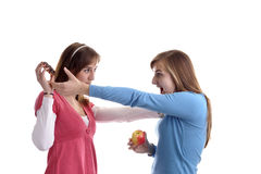 Two young women fighting for a wafel Royalty Free Stock Photo