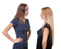 Two young women find out the relationship isolated on white Royalty Free Stock Photography