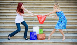 Two young women fioghting Stock Photo