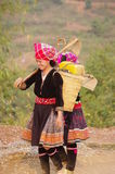 Two young women Flowered Hmong. Two young women returning from the fields. Their dress is not folklore they wear daily to work Stock Images