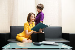 Two young women with a folder at office Royalty Free Stock Photography