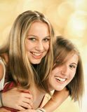 Two young women fool around Stock Photos
