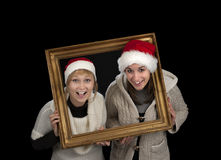 Two young women in a frame, Stock Photos