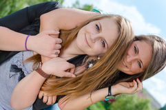Two young women Friends Laughing  in spring or summer outdoors Royalty Free Stock Photo