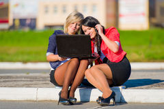 Two young women friends outdoors with a laptop Stock Photography
