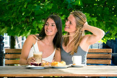 Two young women friends in street cafe Stock Photography