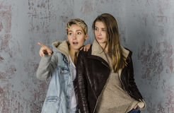 Two young women friends talking Stock Images