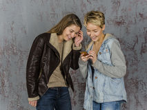 Two young women friends talking Royalty Free Stock Photography