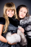Two young women with fur coats Stock Photo