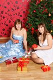 Two young  women with gifts Stock Photos