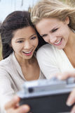 Two Young Women Girls Taking Selfie Photograph Royalty Free Stock Photos