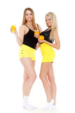 Young women with  oranges and juice. Stock Photography