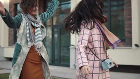 Carefree girlfriends are walking around the city and fooling around stock video footage