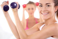 Two young women in the gym Royalty Free Stock Photos